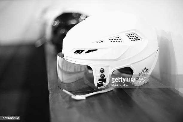 Players helmets are seen on the bench before play during the 2015 Ice Hockey Classic match between the Unites States and Canada at Allphones Arena on...