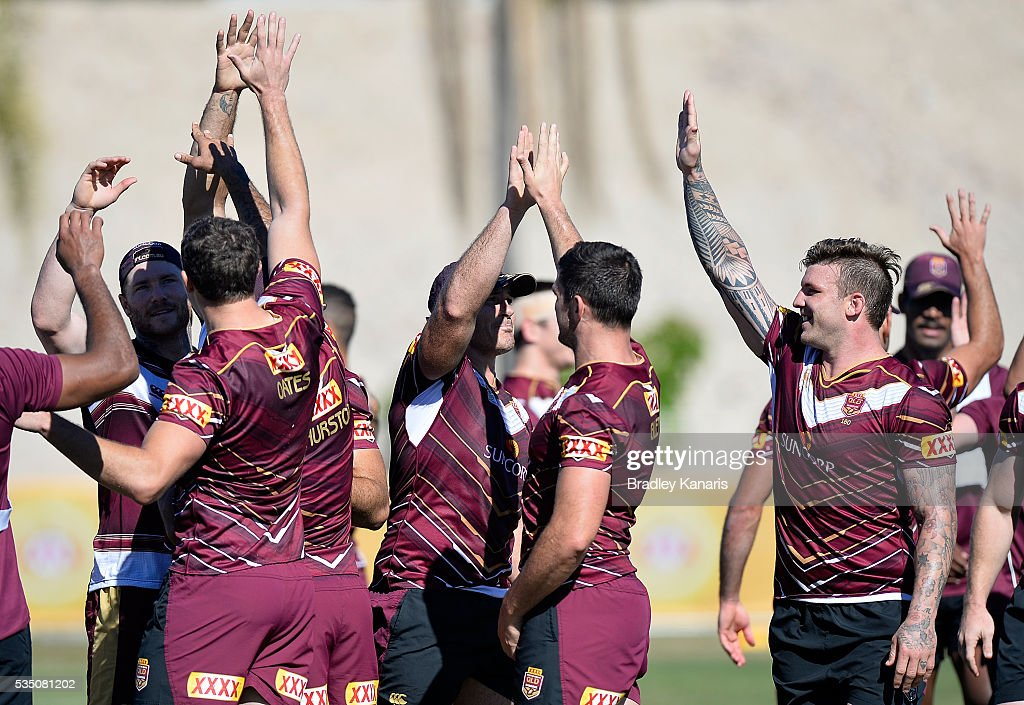 Players high five each other during a Queensland Maroons State of Origin training session on May 29, 2016 in Gold Coast, Australia.