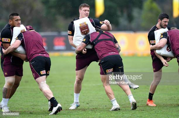 Players hit the tackling pads during a Queensland Maroons State of Origin training session at Sanctuary Cove on July 7 2017 in Brisbane Australia