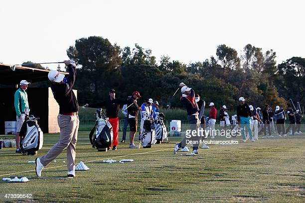 Players hits practice shots on the driving range prior to Day 2 of the Open de Espana held at Real Club de Golf el Prat on May 15 2015 in Barcelona...