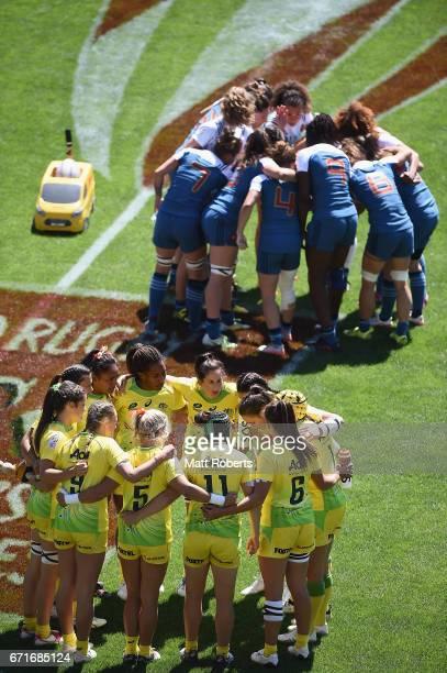 Players huddle before the HSBC World Rugby Women's Sevens Series 2016/17 Kitakyushu quarter final between Australia and France at Kitakyushu Stadium...