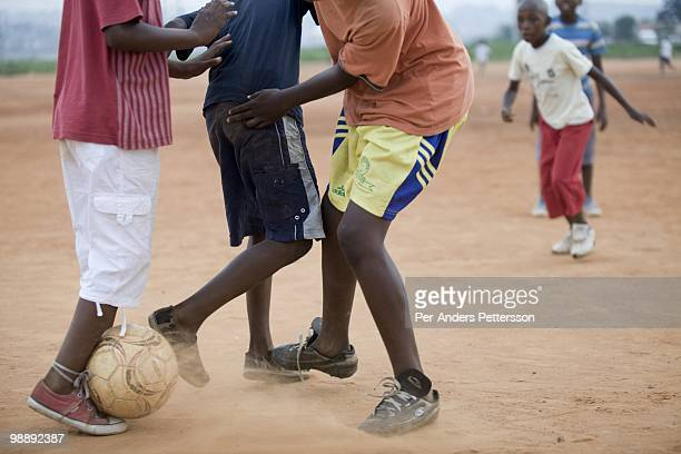 Players in a youth team practice on a field on January 13 in the Diepkloof section of Soweto South Africa The young players practice several time a...