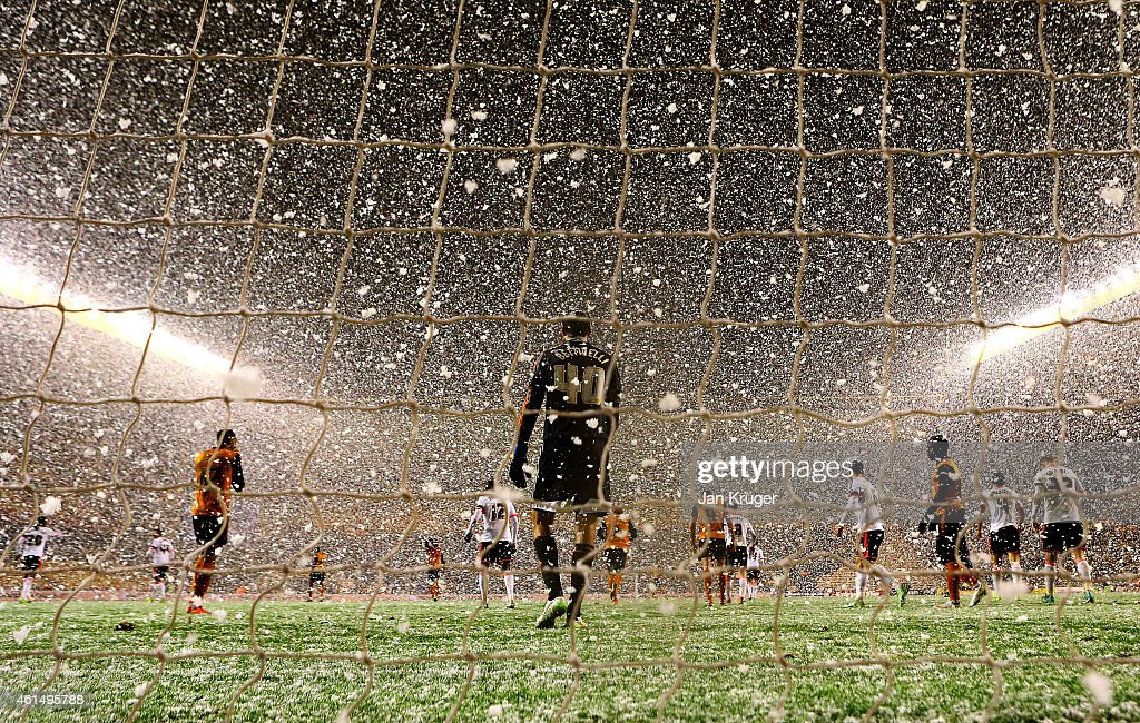 Players in action as snow falls during the FA Cup third round replay match between Wolverhampton Wanderers and Fulham at Molineux on January 13 2015...