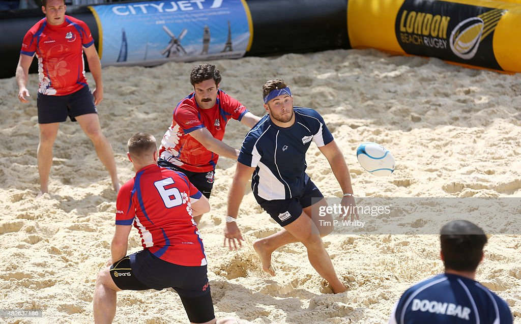 Players in action at London Beach Rugby 2015, a two day touch rugby ...