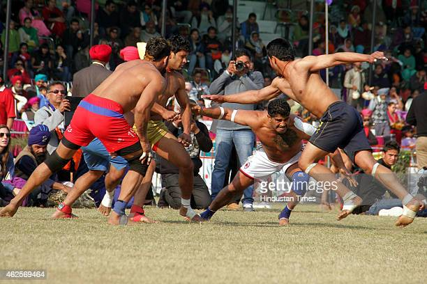 Players in action during a Kabaddi match at 79th Kila Raipur rural sports festival at village Kila Raipur on January 29 2015 in Ludhiana India First...
