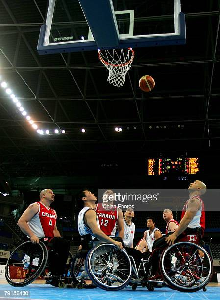 Players in action during a match between China and Canada at the last preliminary round of men's event at the 'Good Luck Beijing' 2008 Wheelchair...