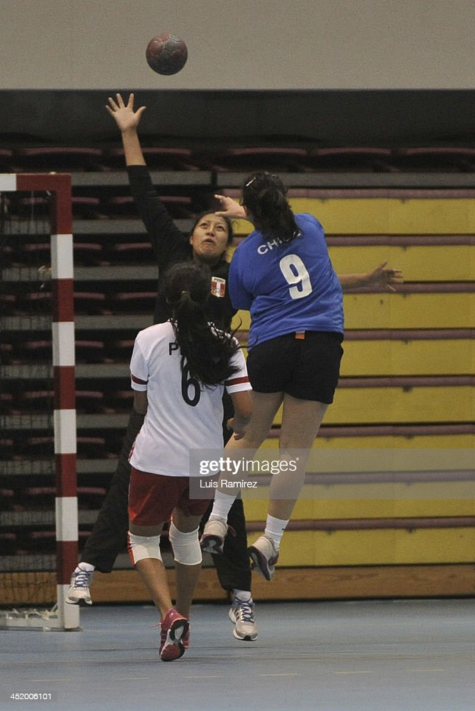 Players in action during a match between Peru and Chile in Women's handball as part of the XVII Bolivarian Games Trujillo 2013 at Colegio San Agustin on November 25, 2013 in Chiclayo, Peru.
