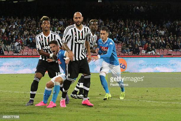 Players in action during soccer match between SSC Napoli and Juventus at San Paolo Stadium