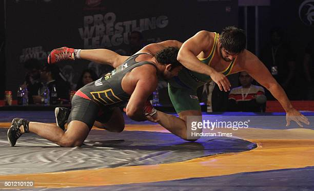 Players in action during the Pro Wrestling League at Guru Nanak Dev Stadium on December 13 2015 in Ludhiana India The league is an initiative of...