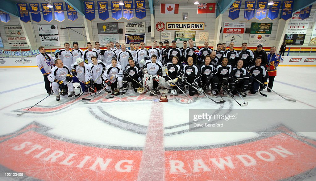 Players in the Celebrity Hockey Game at the Stirling and District Recreation Centre pose for a group photo during Kraft Hockeyville Day 1 on September 30, 2012 in Stirling, Ontario, Canada.