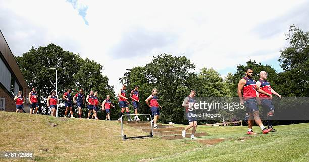 Players in the England Rugby World Cup squad walk onto the pitch during the England training session held at Pennyhill Park on June 23 2015 in...