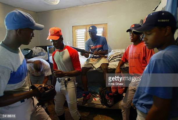 Players in the Latin Baseball Academy get ready for practice in a room with bunk beds that four kids share on August 19 in Consuelo Dominican...
