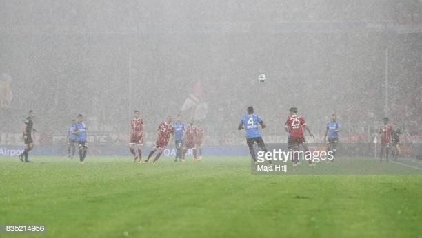 Players in the rain during the Bundesliga match between FC Bayern Muenchen and Bayer 04 Leverkusen at Allianz Arena on August 18 2017 in Munich...