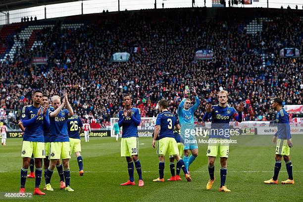 Players including Anwar ElGhazi Richairo Zivkovic Davy Klaassen and Nick Viergever of Ajax applaude their fans after the Dutch Eredivisie match...