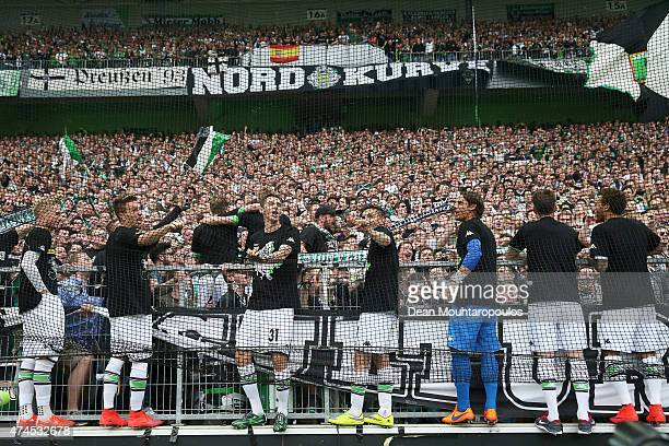 Players including captain Patrick Herrmann of Borussia Moenchengladbach sing with the fans after the Bundesliga match between Borussia...