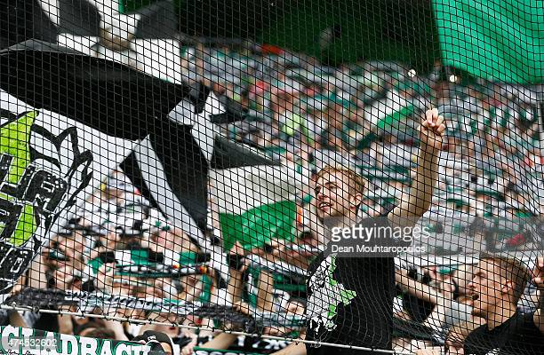 Players including Christoph Kramer and Max Kruse of Borussia Moenchengladbach sing with the fans after the Bundesliga match between Borussia...