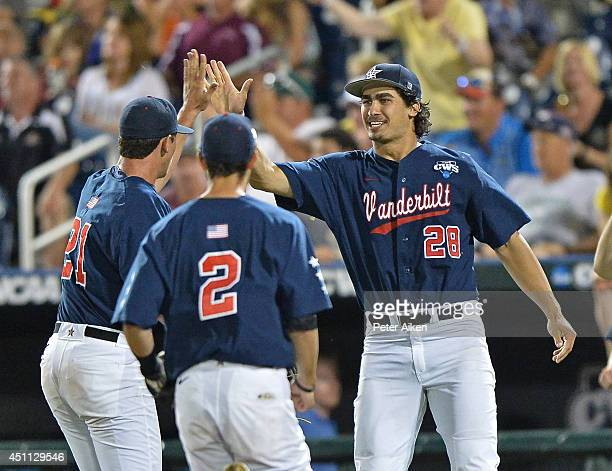 Players Jared Miller Tyler Campbell and John Kilichowski of the Vanderbilt Commodores celebrate at the end of the eighth inning againt the Virginia...