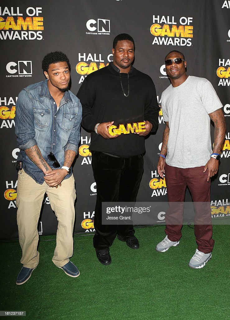 NFL players Jimmy Smith, <a gi-track='captionPersonalityLinkClicked' href=/galleries/search?phrase=Bryant+McKinnie&family=editorial&specificpeople=2648683 ng-click='$event.stopPropagation()'>Bryant McKinnie</a> and <a gi-track='captionPersonalityLinkClicked' href=/galleries/search?phrase=Jacoby+Jones&family=editorial&specificpeople=4167942 ng-click='$event.stopPropagation()'>Jacoby Jones</a> attend the Third Annual Hall of Game Awards hosted by Cartoon Network at Barker Hangar on February 9, 2013 in Santa Monica, California. 23270_004_JG_0211.JPG