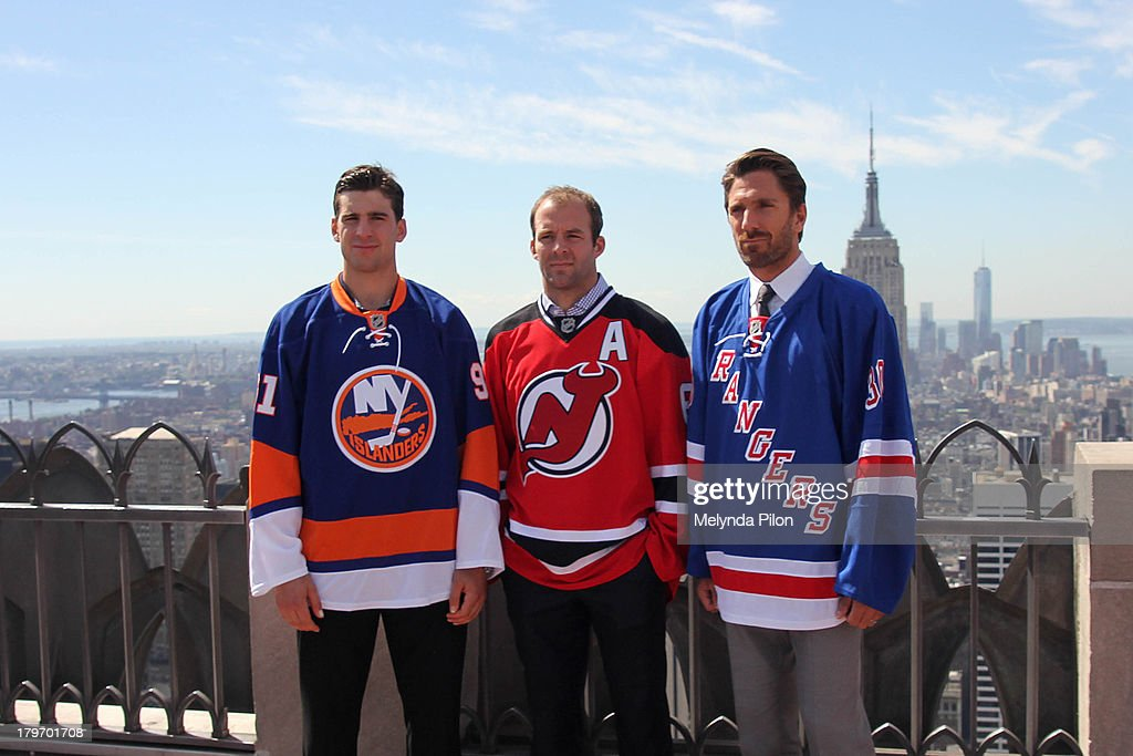 NHL players (L to R) <a gi-track='captionPersonalityLinkClicked' href=/galleries/search?phrase=John+Tavares&family=editorial&specificpeople=601791 ng-click='$event.stopPropagation()'>John Tavares</a> of the New York Islanders, <a gi-track='captionPersonalityLinkClicked' href=/galleries/search?phrase=Andy+Greene&family=editorial&specificpeople=3568726 ng-click='$event.stopPropagation()'>Andy Greene</a> of the New Jersey Devils, <a gi-track='captionPersonalityLinkClicked' href=/galleries/search?phrase=Henrik+Lundqvist&family=editorial&specificpeople=217958 ng-click='$event.stopPropagation()'>Henrik Lundqvist</a> of the New York Rangers visit the Top of the Rock to celebrate the start of the 2013-14 NHL season, including the six regular-season games set to be played in outdoor locations, at the Top of the Rock Observation Deck at Rockefeller Center on September 6, 2013 in New York City.