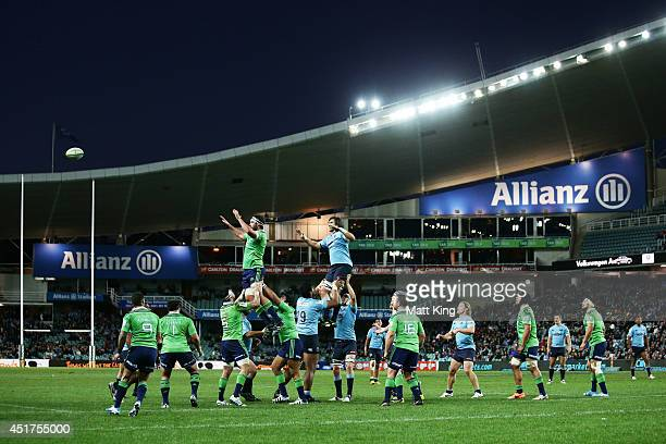 Players jump at the lineout during the round 18 Super Rugby match between the Waratahs and the Highlanders at Allianz Stadium on July 6 2014 in...