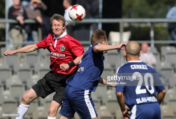 Players jump for a header during the half final match between SpVg Blau Weiss 1890 and Hannover 96 during the DFB over 40 and 50 cup at...