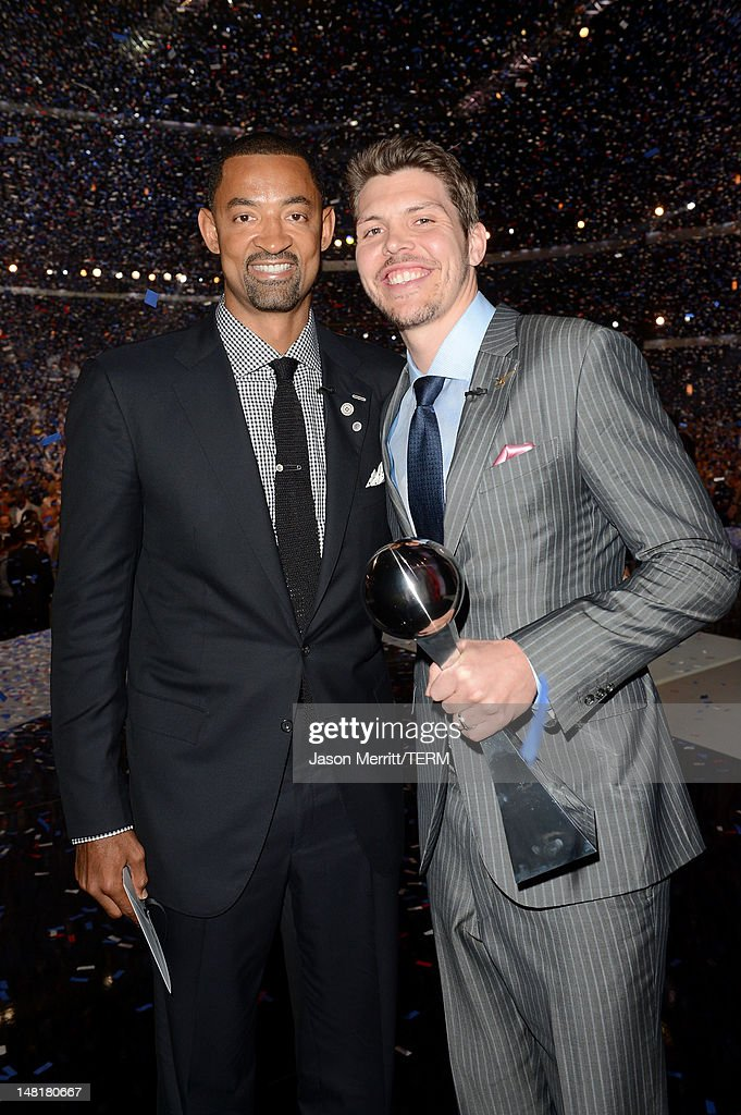 NBA players <a gi-track='captionPersonalityLinkClicked' href=/galleries/search?phrase=Juwan+Howard&family=editorial&specificpeople=201642 ng-click='$event.stopPropagation()'>Juwan Howard</a> (L) and <a gi-track='captionPersonalityLinkClicked' href=/galleries/search?phrase=Mike+Miller+-+Basketball+Player&family=editorial&specificpeople=201801 ng-click='$event.stopPropagation()'>Mike Miller</a> of the Miami Heat, winners of the Best Team Award pose onstage during the 2012 ESPY Awards at Nokia Theatre L.A. Live on July 11, 2012 in Los Angeles, California.