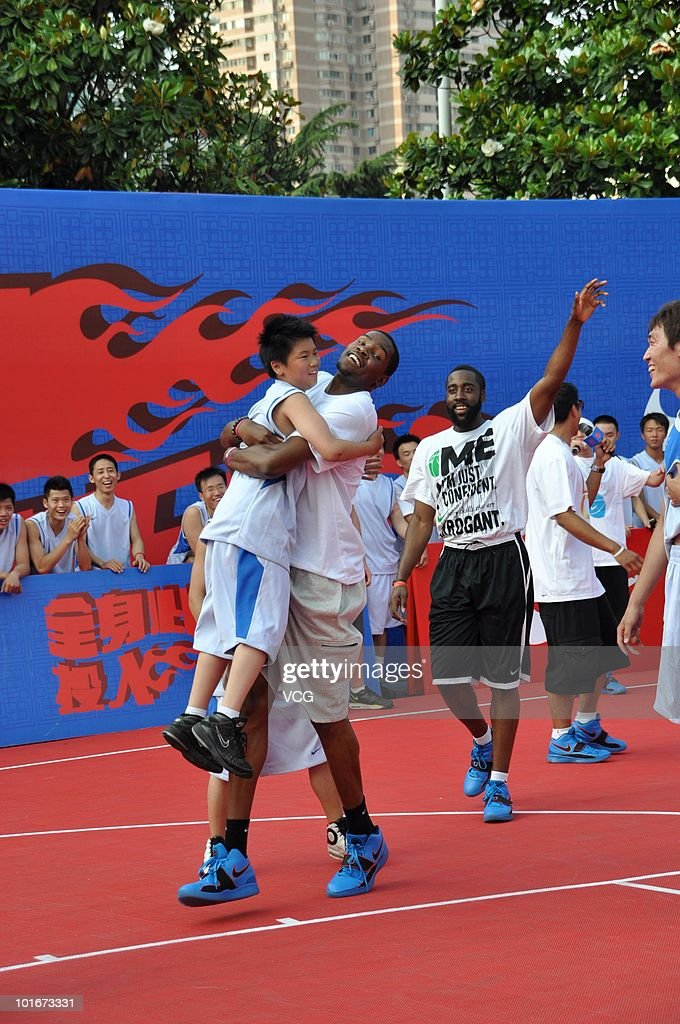 NBA players Kevin Durant(L) and James Harden of the Oklahoma City Thunder, celebrates with a participant during a NIKE training camp on June 6, 2010 in Shanghai, China.