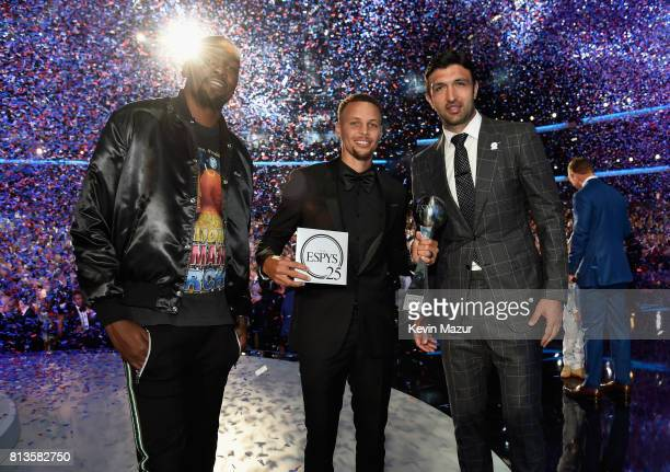 NBA players Kevin Durant Steph Curry and Zaza Pachulia accept the Best Team award on behalf of the NBA champion Golden State Warriors onstage at The...