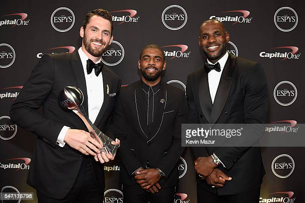 NBA players Kevin Love Kyrie Irving and LeBron James pose with the award for Best Moment at the 2016 ESPYS at Microsoft Theater on July 13 2016 in...