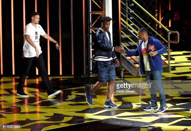 NBA players Klay Thompson and Jimmy Butler and host Russell Wilson speak onstage during Nickelodeon Kids' Choice Sports Awards 2017 at Pauley...