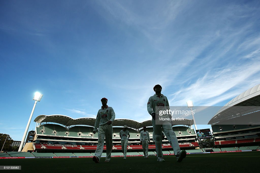 Players leave the field at the tea brake during day one of the Sheffield Shield match between South Australia and Victoria at Adelaide Oval on February 14, 2016 in Adelaide, Australia.