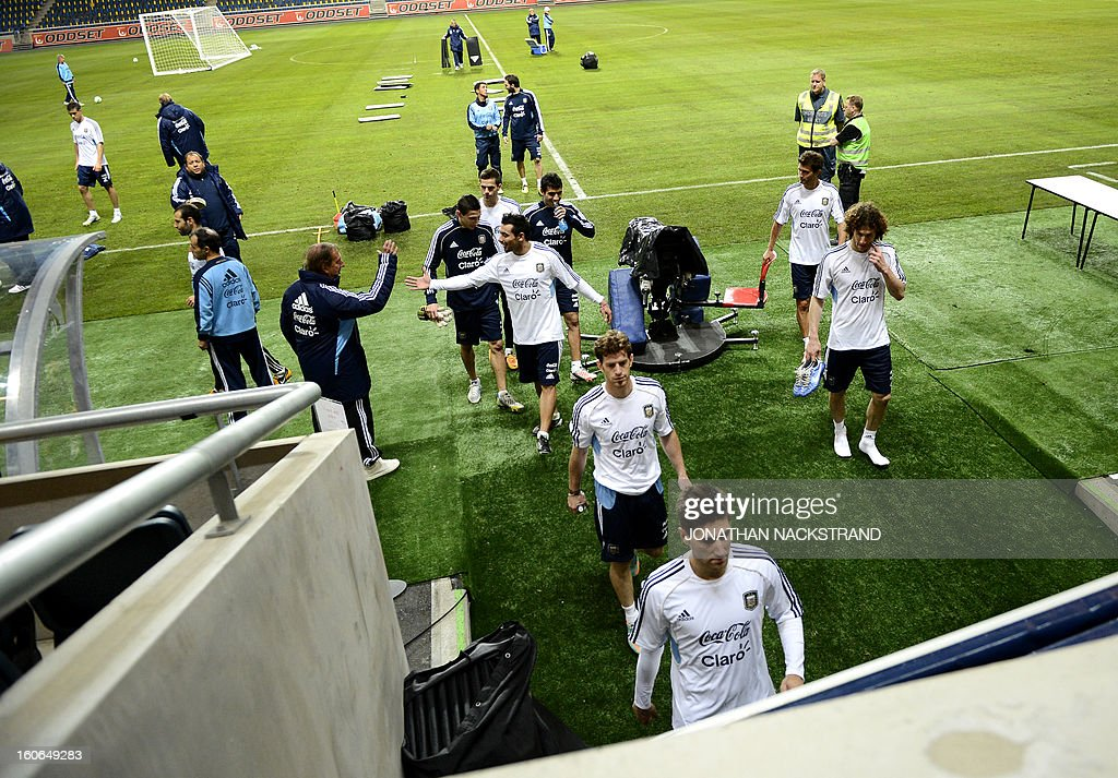 Players leave the pitch after a training session of the Argentina national football team at the 'Friends Arena' in Stockholm, Sweden, on February 4, 2013 two days before the FIFA World Cup 2014 friendly match Sweden vs Argentina.