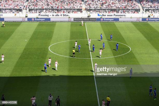 Players leave the pitch as referee Christian Dingert suspends the match after fans of Karlsruhe threw flares onto the pitch during the Second...