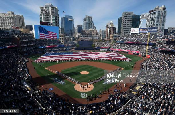 Players line the field during an opening day ceremony before a baseball game between the San Francisco Giants and the San Diego Padres at PETCO Park...