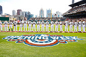 Players line up along the first and third base lines prior to the start of the Opening Day game between the Pittsburgh Pirates and the Detroit Tigers...