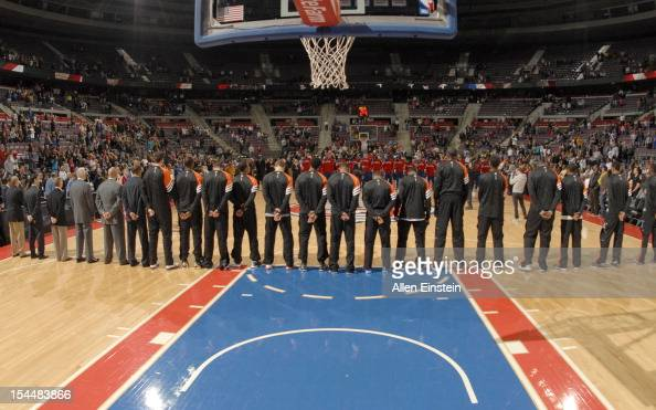 Players line up during the preseason game between the Charlotte Bobcats and the Detroit Pistons on October 20 2012 at The Palace of Auburn Hills in...
