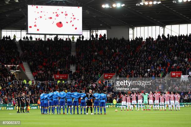 Players line up for a minute's silence ahead of Remembrance Sunday prior to the Premier League match between Stoke City and Leicester City at Bet365...