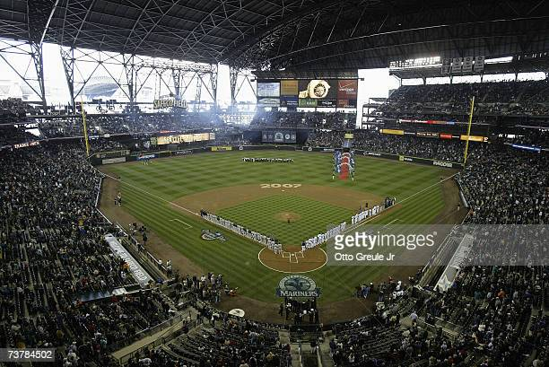 Players line up for the National Anthem before the Seattle Mariners Home Opener against the Oakland Athletics at Safeco Field on April 2 2007 in...