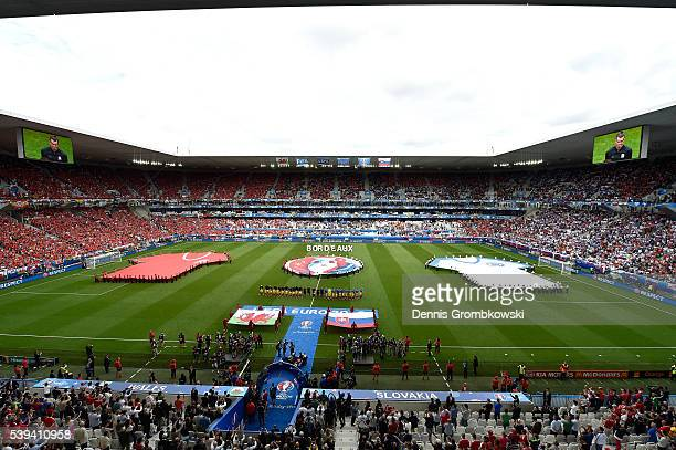 Players line up for the national anthem prior to the UEFA EURO 2016 Group B match between Wales and Slovakia at Stade Matmut Atlantique on June 11...