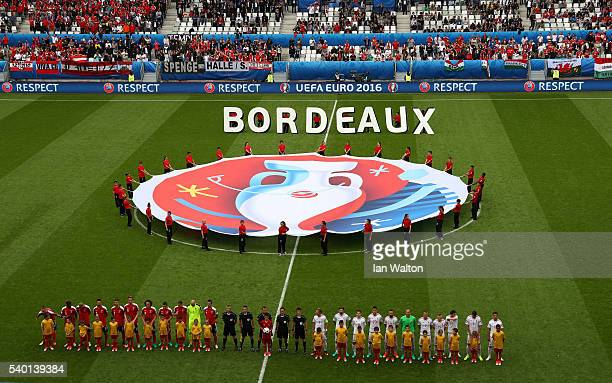 Players line up for the national anthem prior to the UEFA EURO 2016 Group F match between Austria and Hungary at Stade Matmut Atlantique on June 14...