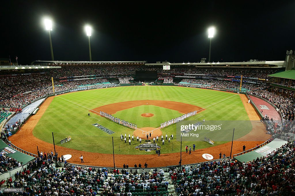Players line up for the national anthems during the opening match of the MLB season between the Los Angeles Dodgers and the Arizona Diamondbacks at Sydney Cricket Ground on March 22, 2014 in Sydney, Australia.