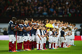 Players line up for the national anthems prior to the International Friendly match between England and France at Wembley Stadium on November 17 2015...