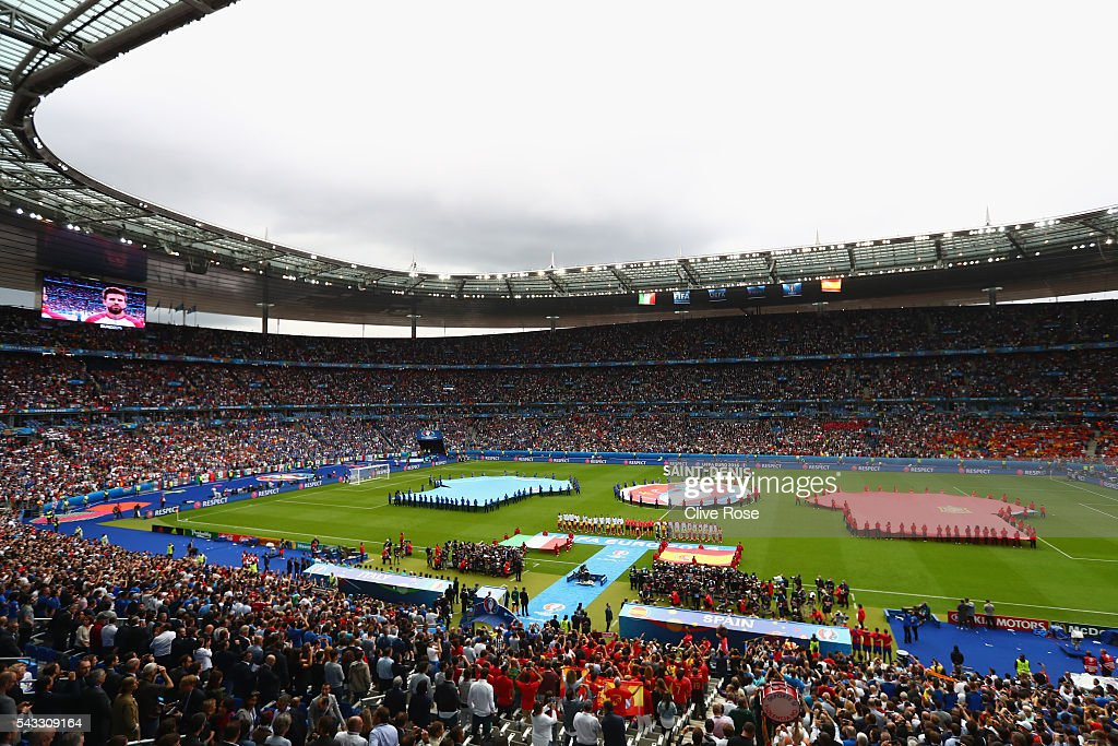 Players line up for the national anthems prior to the UEFA EURO 2016 round of 16 match between Italy and Spain at Stade de France on June 27, 2016 in Paris, France.