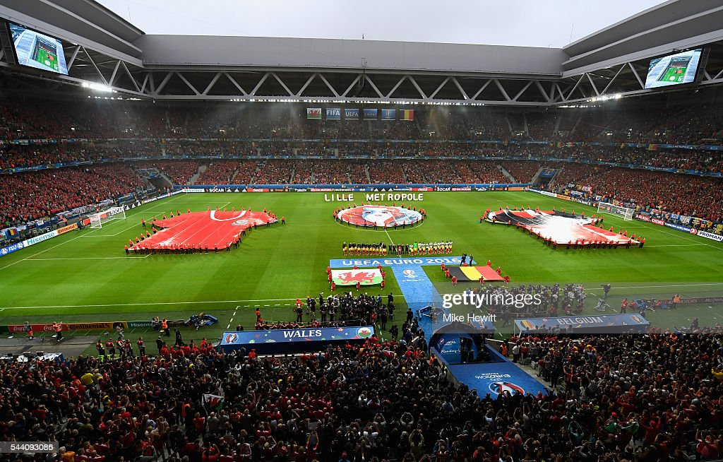 Players line up for the national anthems prior to the UEFA EURO 2016 quarter final match between Wales and Belgium at Stade Pierre-Mauroy on July 1, 2016 in Lille, France.