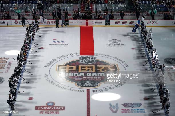 Players line up for the opening ceremony during a preseason National Hockey League game between the Vancouver Canucks and the Los Angeles Kings at...