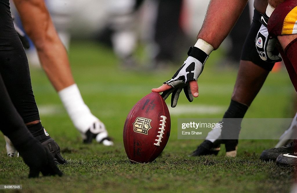 Players line up on the line of scrimmage during the Oakland Raiders game against the Washington Redskins at OaklandAlameda County Coliseum on...