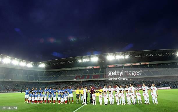 Players line up prior to playing the pre season match between Yokohama F Marinos and VfL Bochum at Nissan Stadium on July 31 2008 in Yokohama...