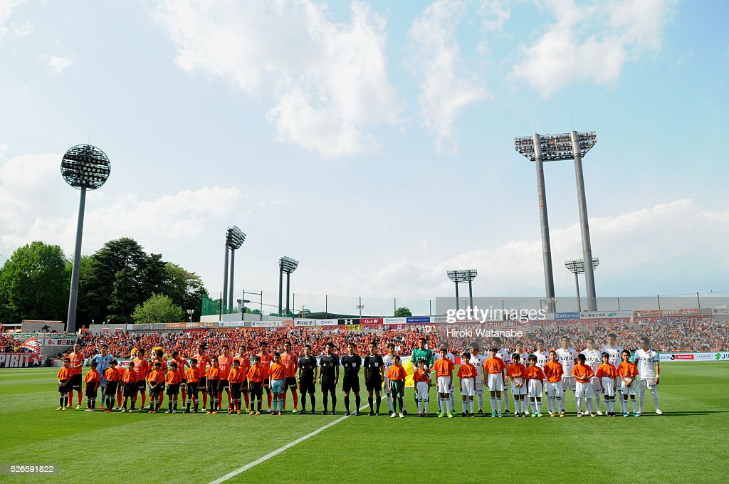Players line up prior to the J.League match between Omiya Ardija and Kashima Antlers at Nack 5 Stadium Omiya on April 30, 2016 in Saitama, Japan.