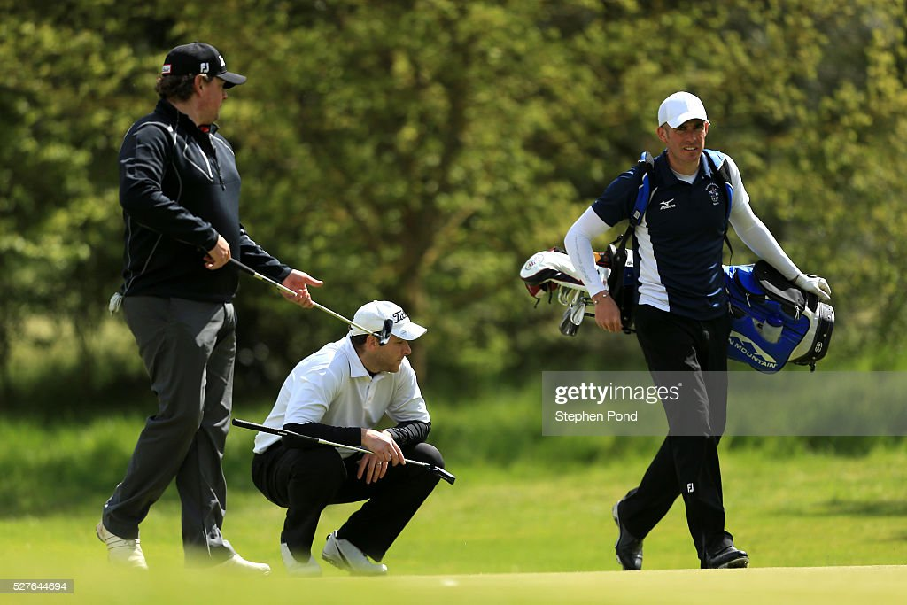 Players line up their putts on a green during the PGA Professional Championship East Qualifier at Gog Magog Golf Club on May 3, 2016 in Cambridge, England.