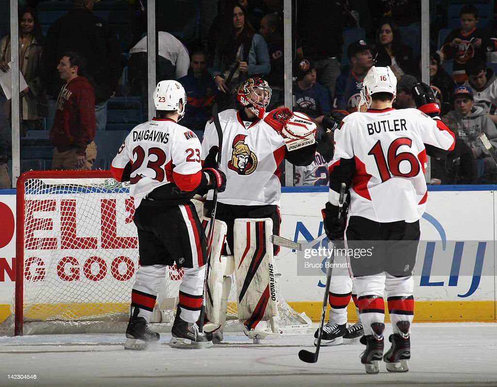 Players line up to congratulate <a gi-track='captionPersonalityLinkClicked' href=/galleries/search?phrase=Craig+Anderson&family=editorial&specificpeople=211238 ng-click='$event.stopPropagation()'>Craig Anderson</a> #41 of the Ottawa Senators following the victory over the New York Islanders at the Nassau Veterans Memorial Coliseum on April 1, 2012 in Uniondale, New York. The Senators defeated the Islanders 5-1 to clinch a playoff berth.